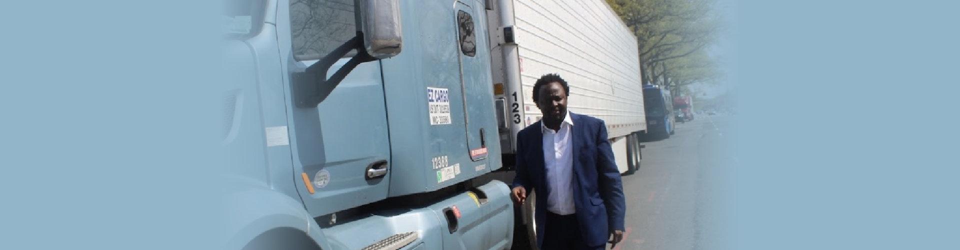 man standing beside the truck